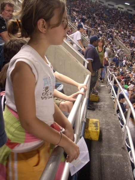 A Yankees game in 2008, Natlie's watching Brett Gardner's first hit for the Yankees.