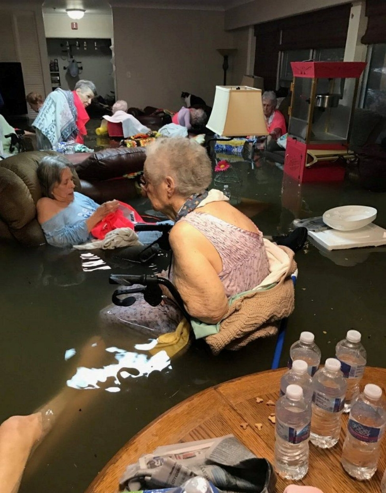 Elderly residents of La Vita Bella care home in storm-hit Texas were rescued after a photo of them part-submerged in water was widely shared on social media. The water went from ankle-deep to waist-deep in about 15 minutes.  by Trudy Lampson via Reuters ( source )