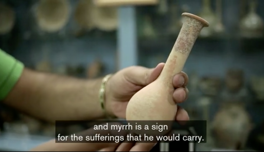An antiquities dealer in Bethlehem shows a traditional container for myrrh, one of the three gifts the Magi brought to Jesus. (screenshot from following video)