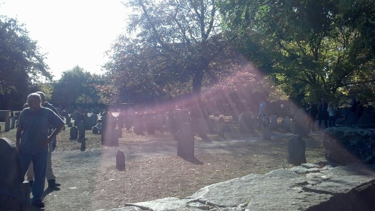 Famous Salem cemetery. Weird sunlight shot I got while sitting on the wall near the graves of those who were put to death.