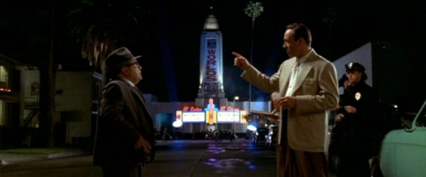 The film weaves through several noir stereotypes, like tabloid magnate (Danny DeVito)