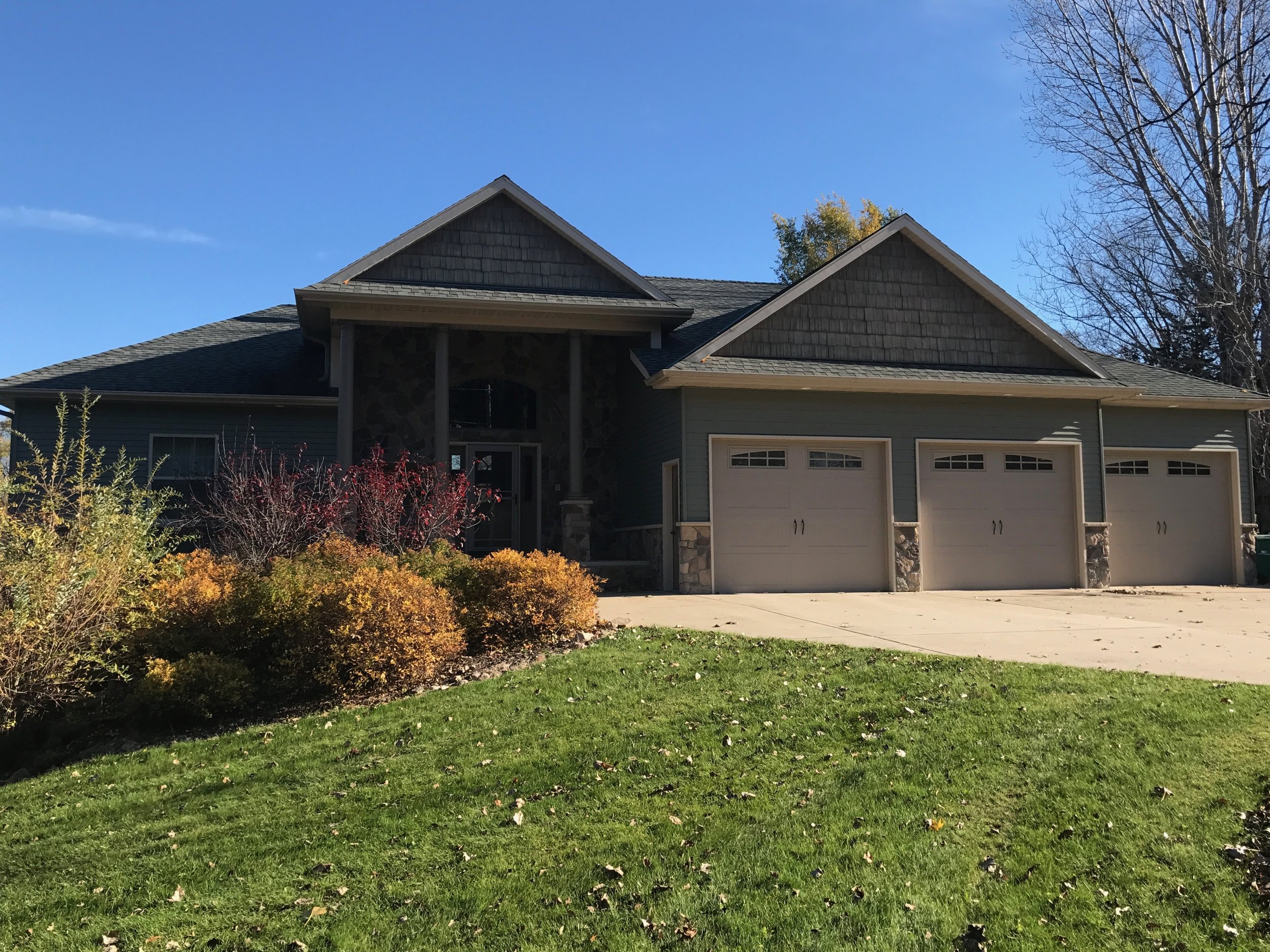 Custom rambler style home built by Bravo Homes by Dean Croat Construction