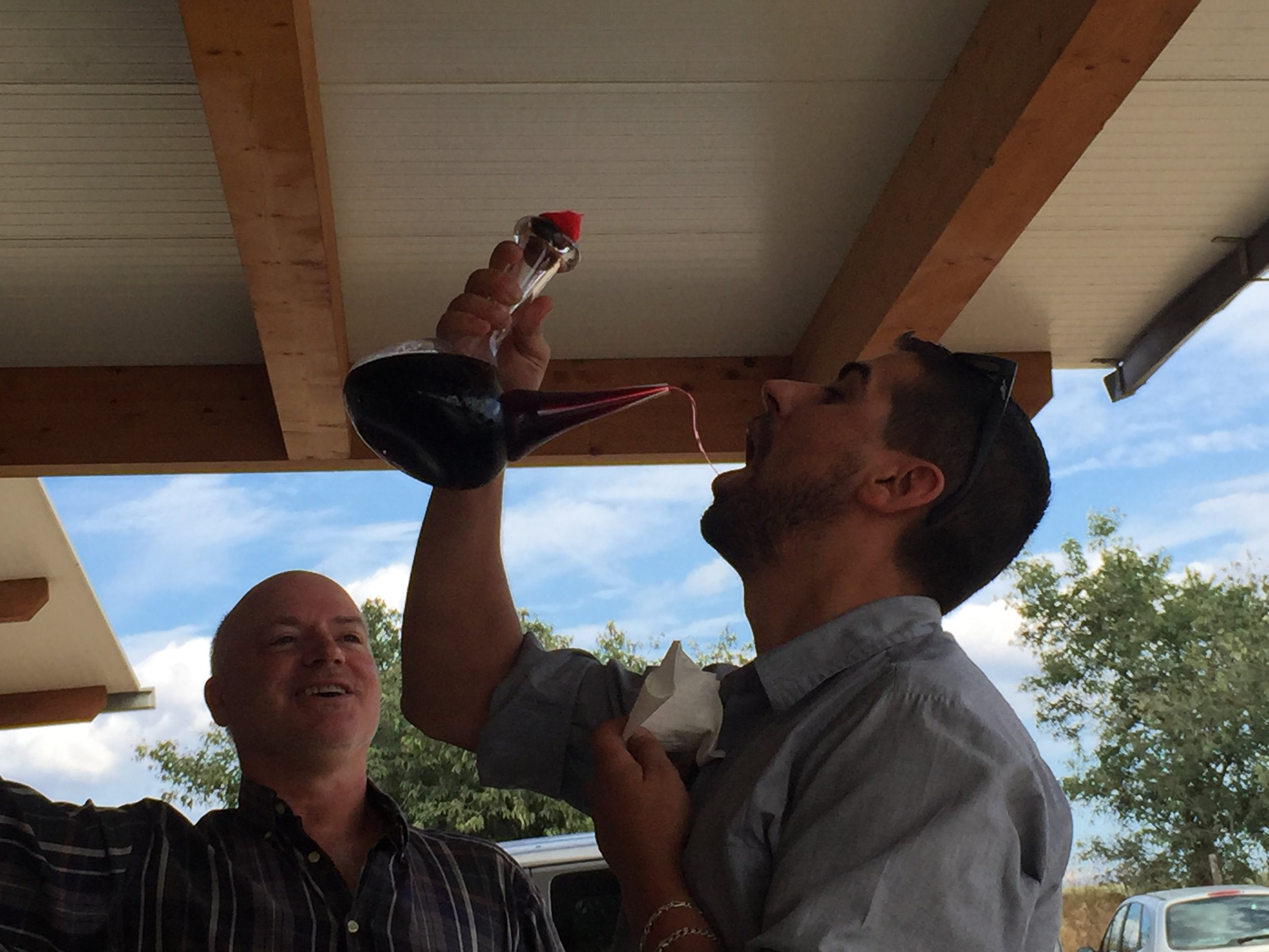 Ruben, our handsome driver demonstrating how to drink the wine with encouragement from our guide for the day, Jack.