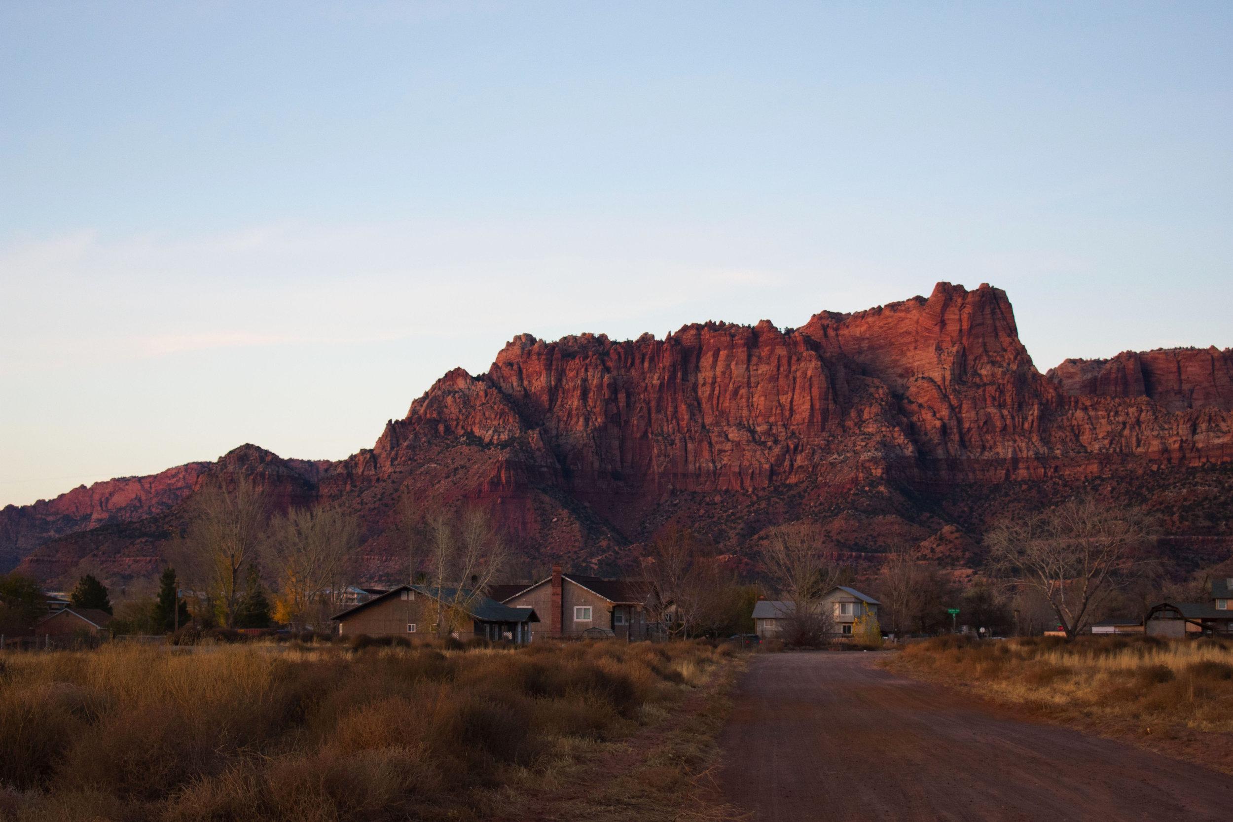 The vermillion cliffs of Short Creek at dusk.