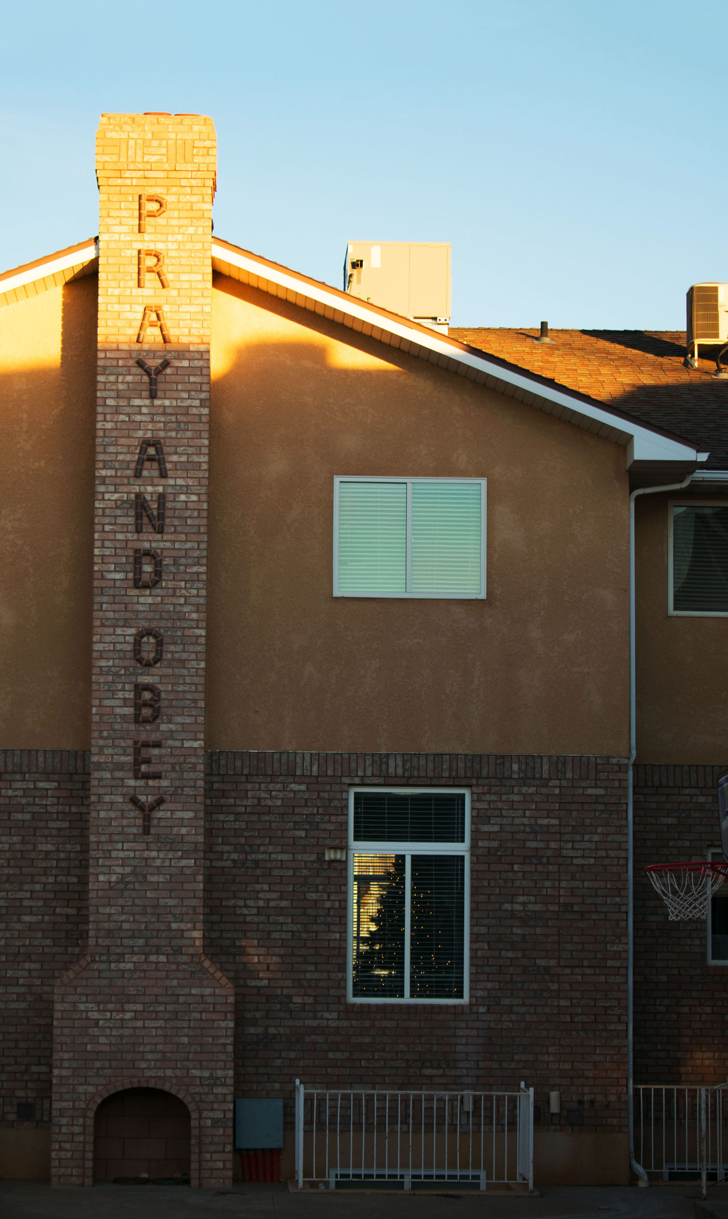 Warren Jeffs' frequent mantra on the chimney outside his old house. Dream Center's Christmas tree is visible through the window.