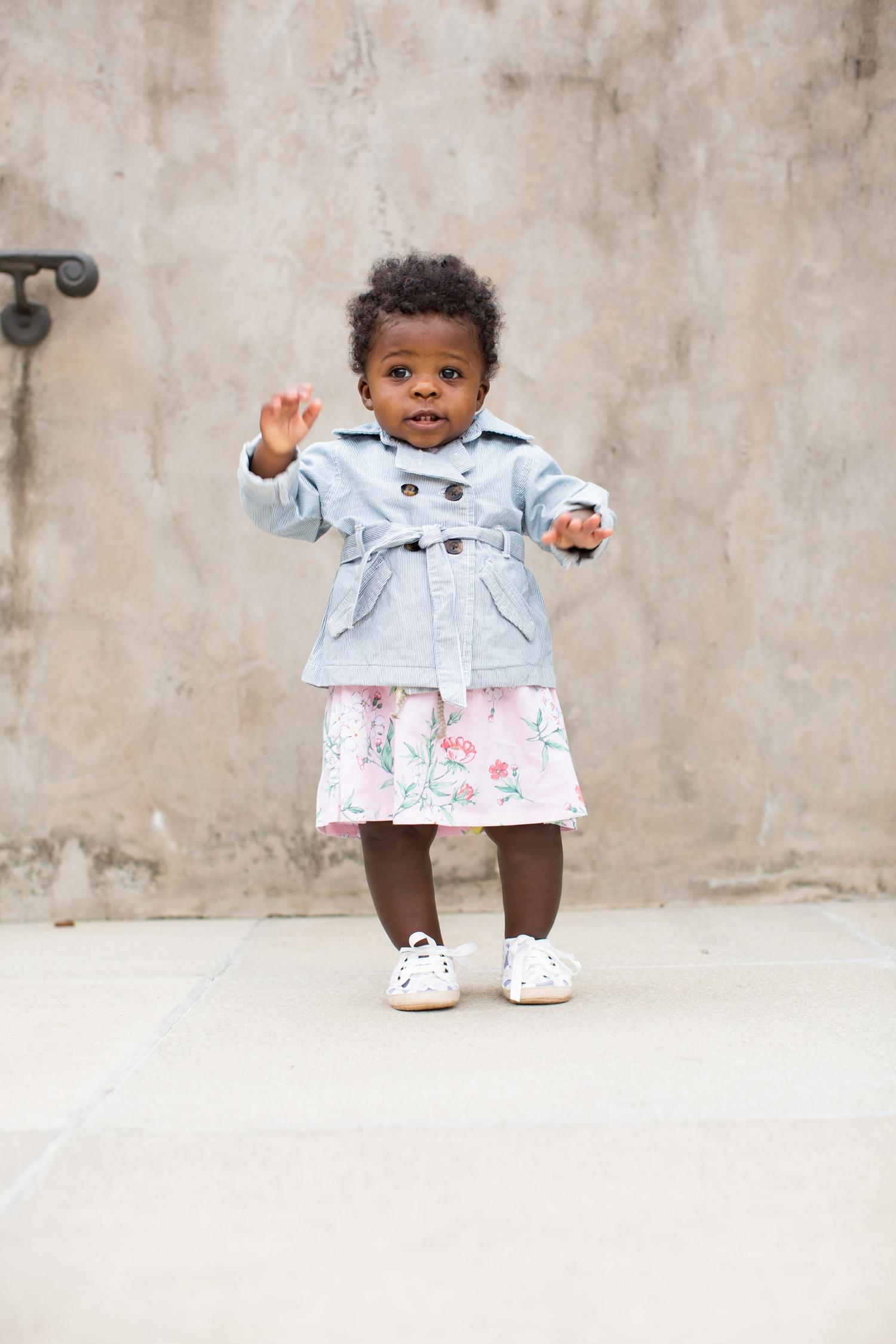 Baby girl in trench coat