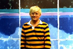 David Hockney in front of a completed work, 1978. Larry Stanton made a film of David making these prints.