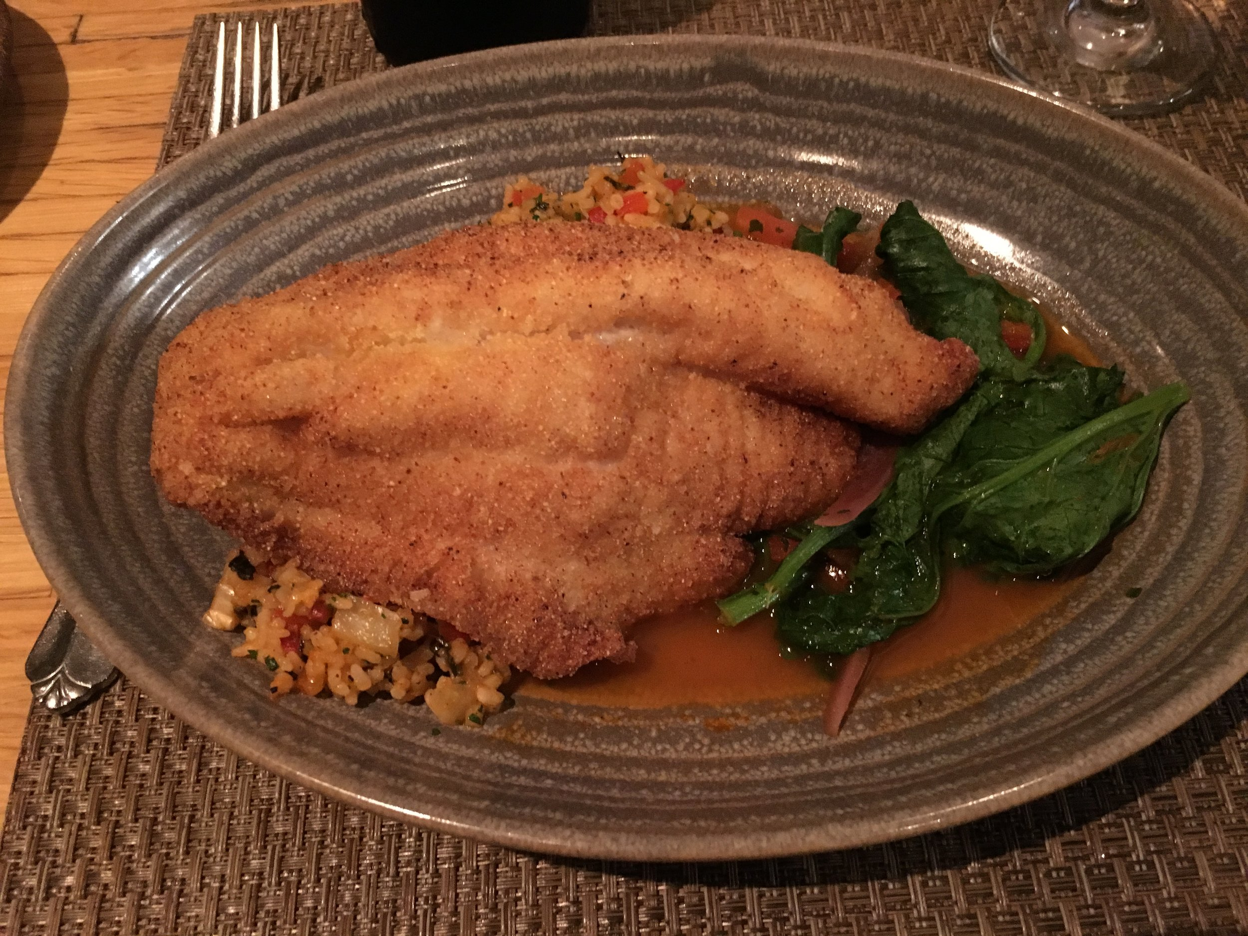 Catfish and Carolina gold rice with a side of rapini.