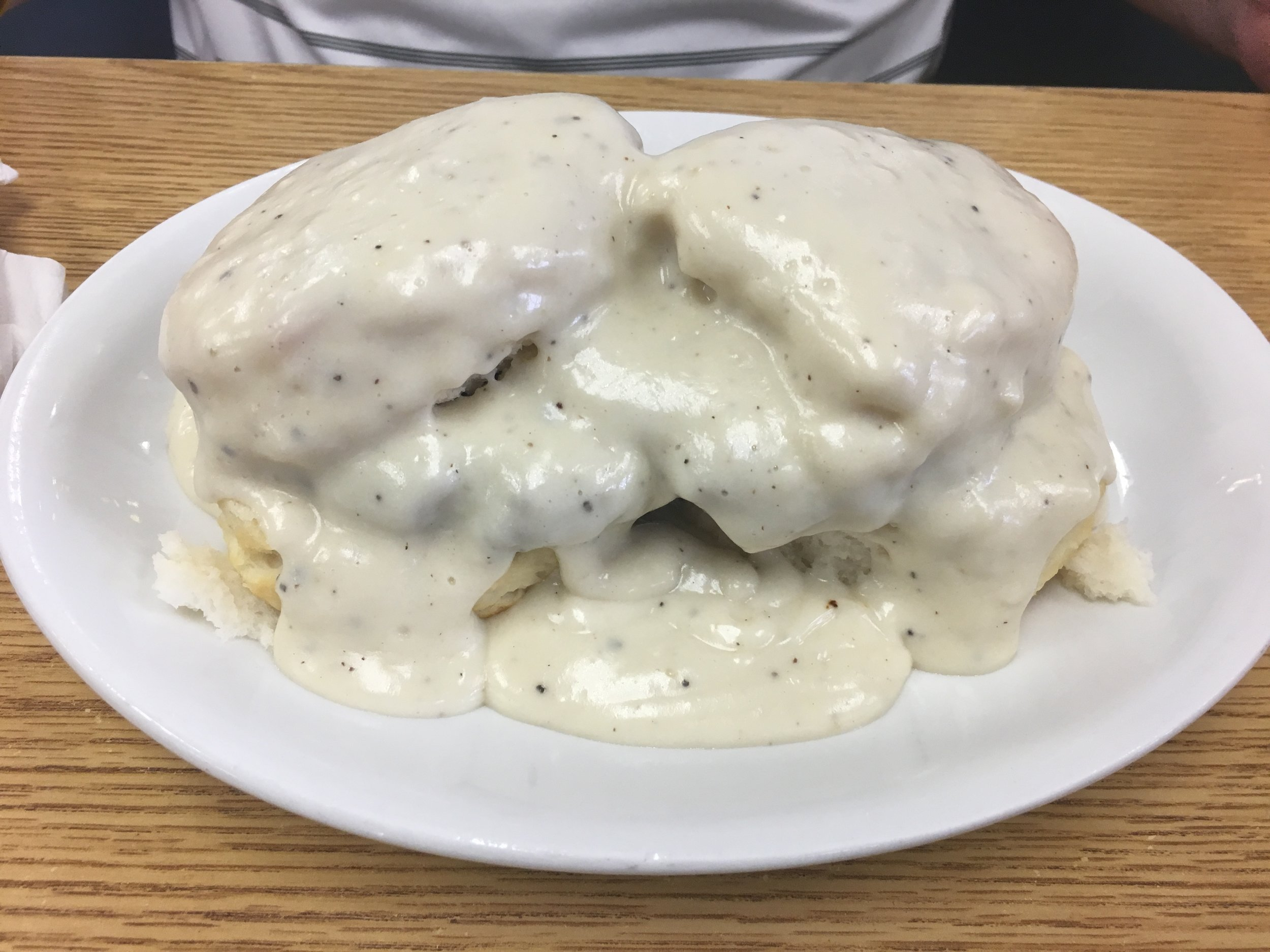 Rich, creamy gravy atop light biscuits. There's even a homemade sausage patty buried under there!
