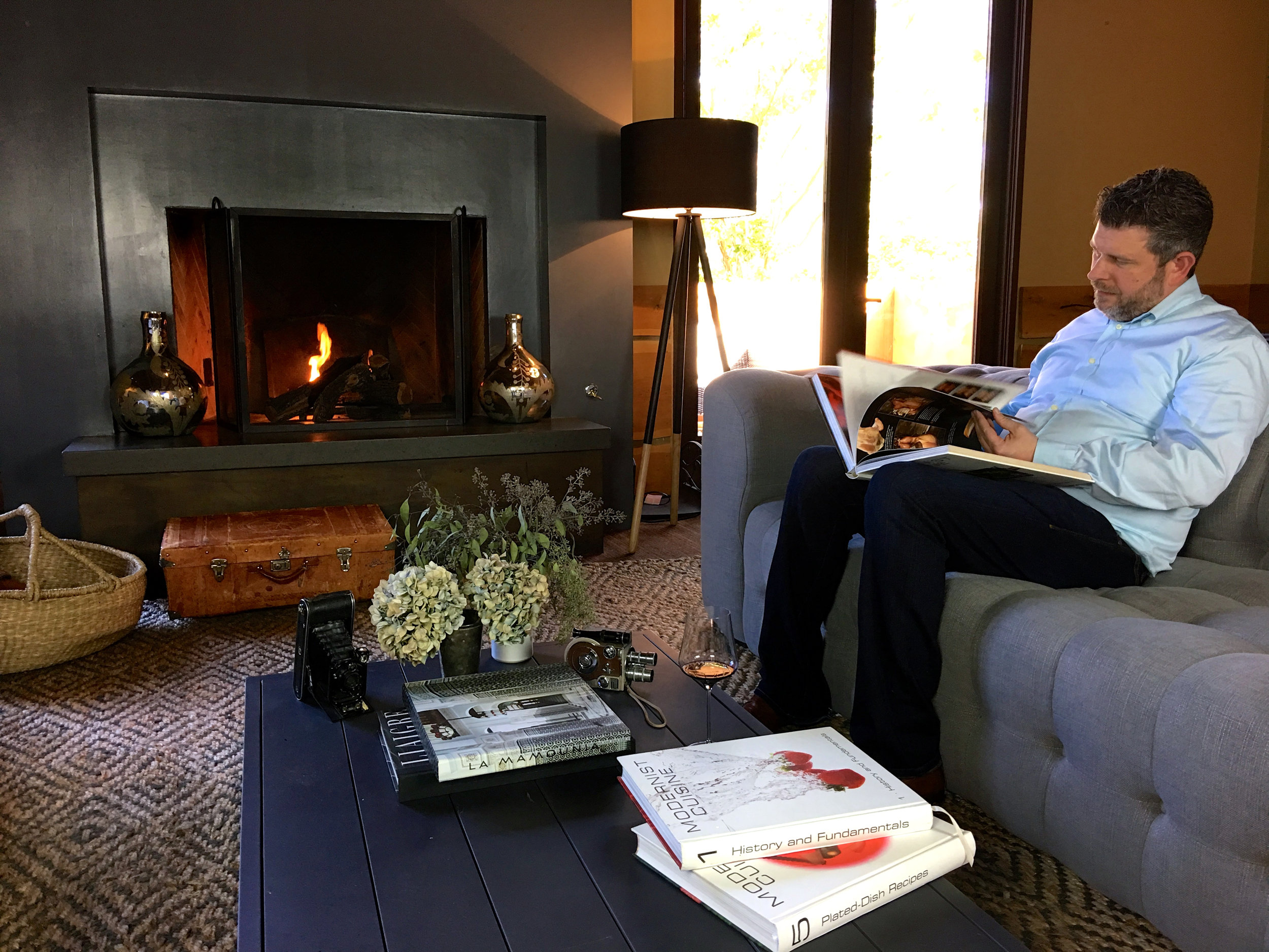 Garret getting recipe inspirations from some of his classic cookbooks ( Photo: Mike Casey,The 29 Napa )