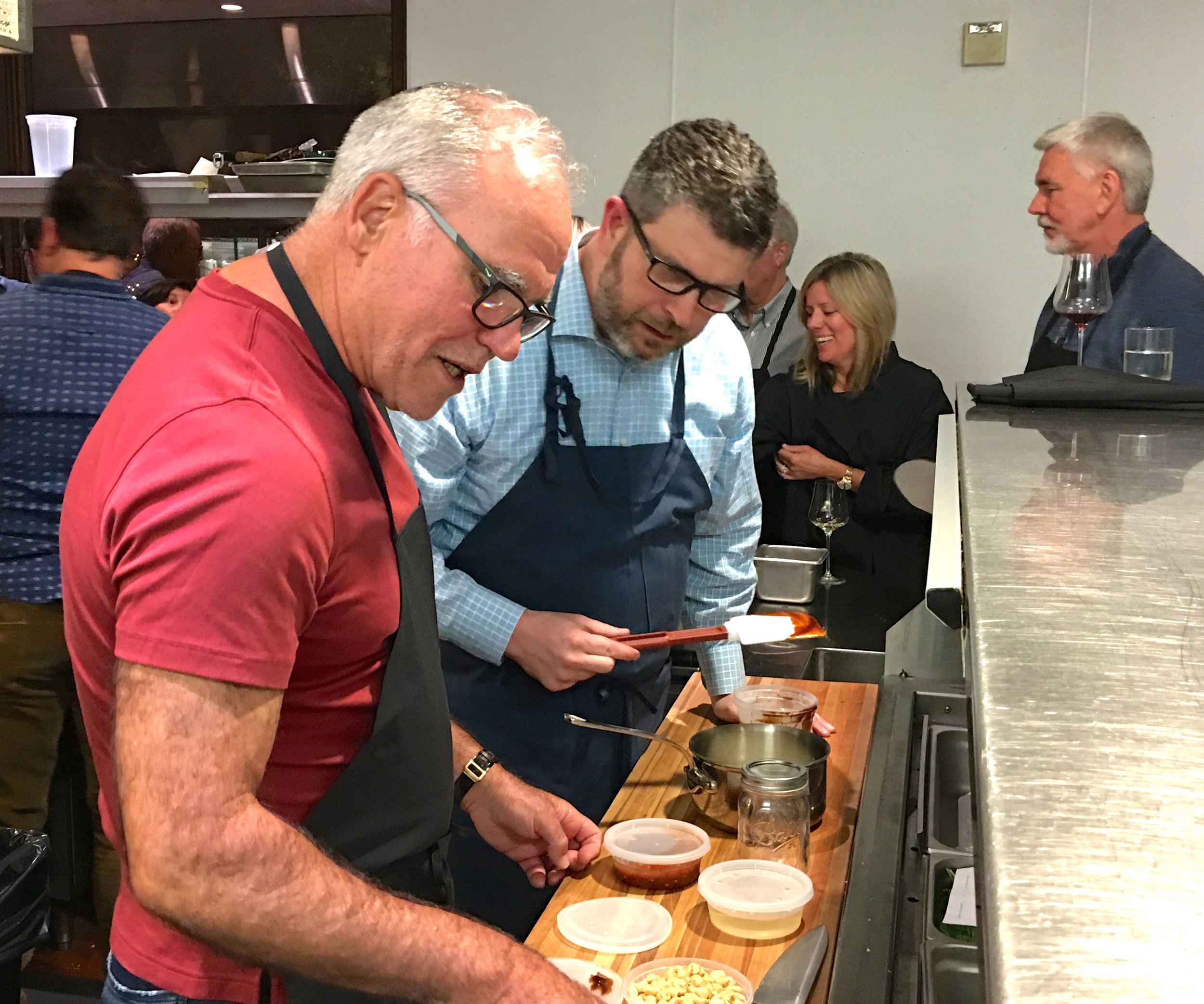 Garret in his favorite place,on the line cooking with members ( Photo: Mike Casey,The 29 Napa )