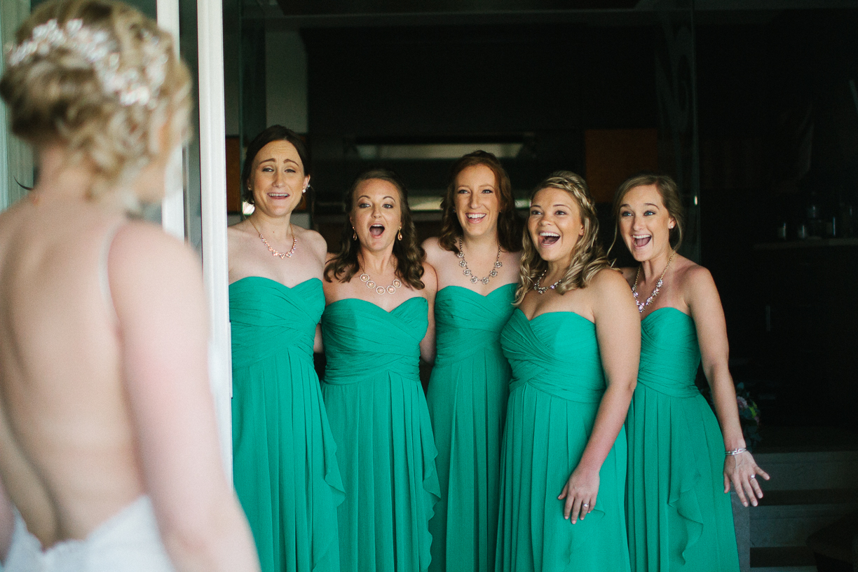 Punta Cana destination wedding, bride surprises her bridesmaids with her first look of wedding gown
