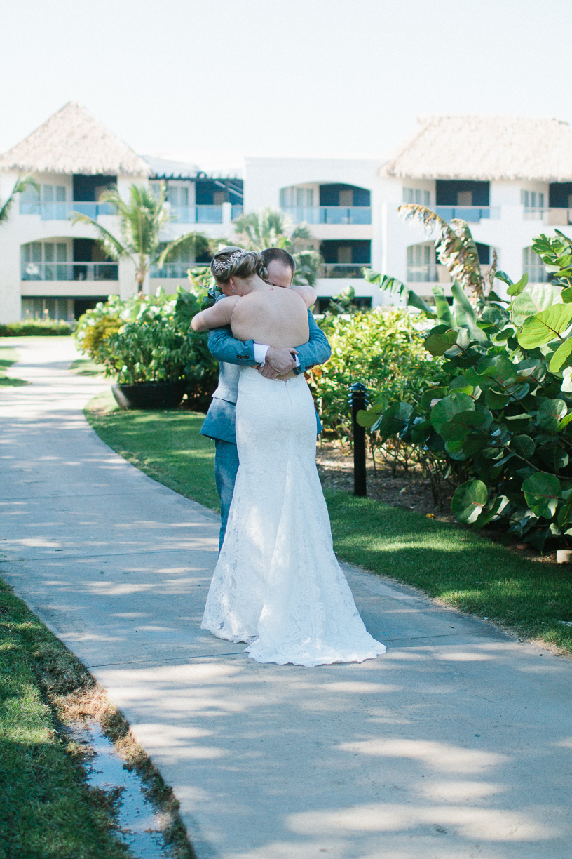 Punta Cana destination wedding, bride and groom embrace during their first look before their ceremony