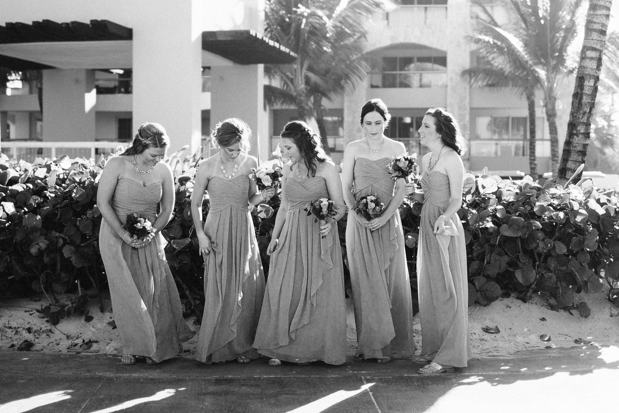Punta Cana destination wedding, bridesmaids pause for a quiet moment before their friends' ceremony