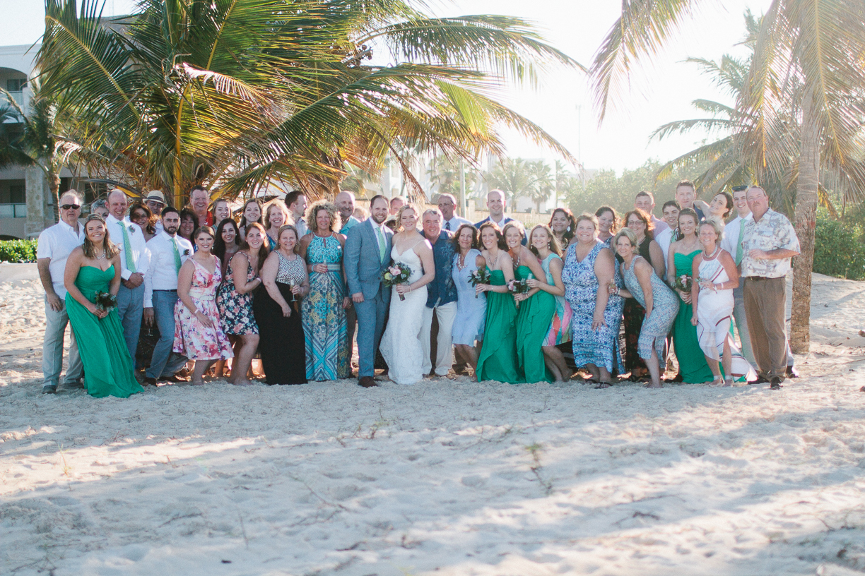 Punta Cana destination wedding, beach front wedding ceremony at sunset, wedding party and guests