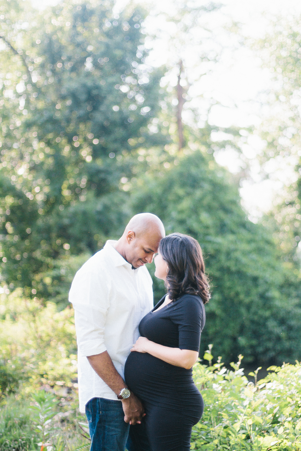 Expecting couple gaze at each other sweetly during a maternity session in Southern New Jersey photographed by Danielle Gallo Photography
