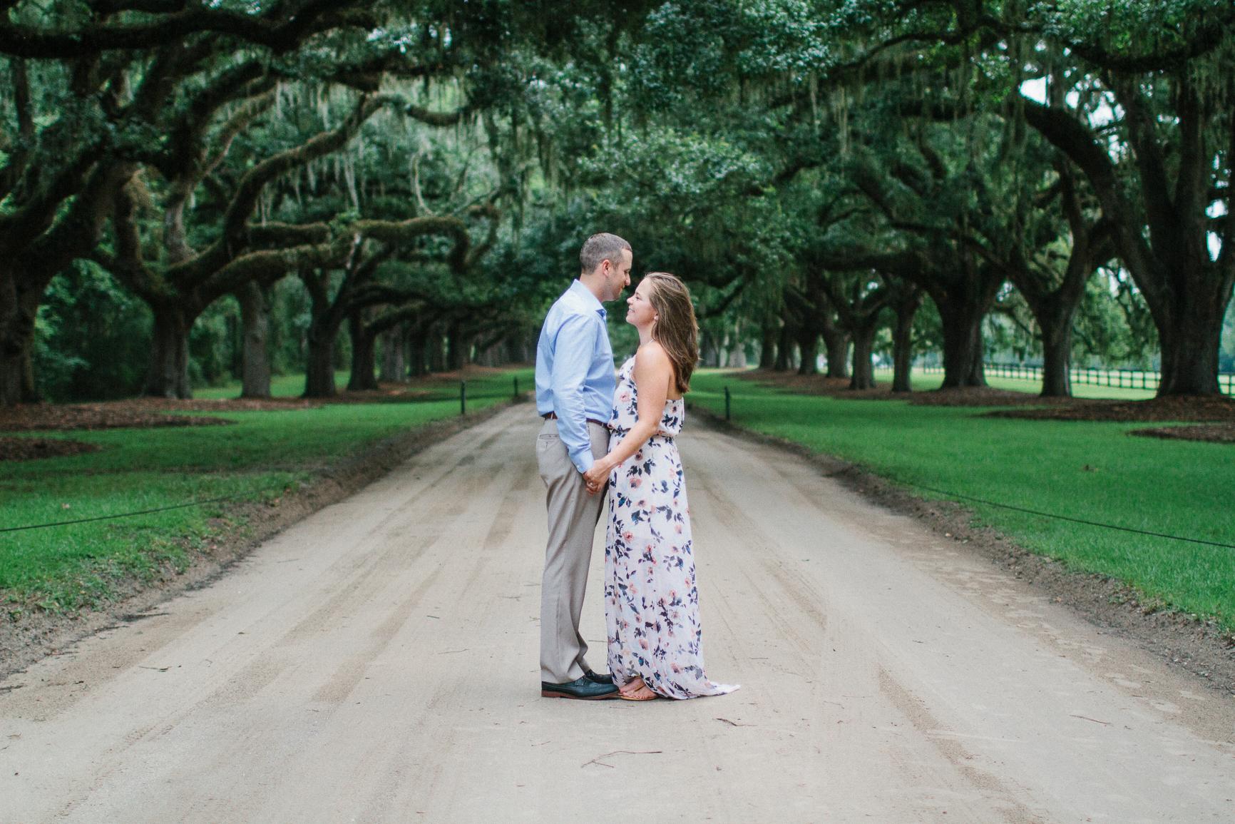 Engaged couple smiling at Boone Hall Plantation, Charleston South Carolina by Danielle Gallo Photography
