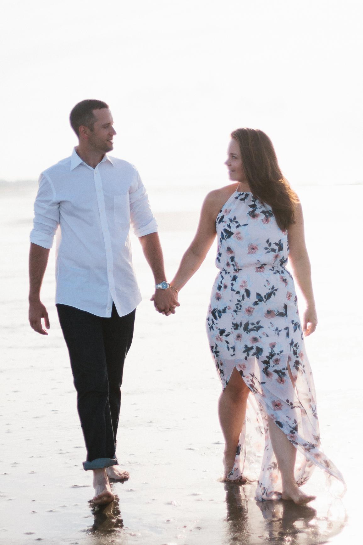 Engaged couple walking on the beach at Kiawah Island Beach Resort, Kiawah Island South Carolina by Danielle Gallo Photography