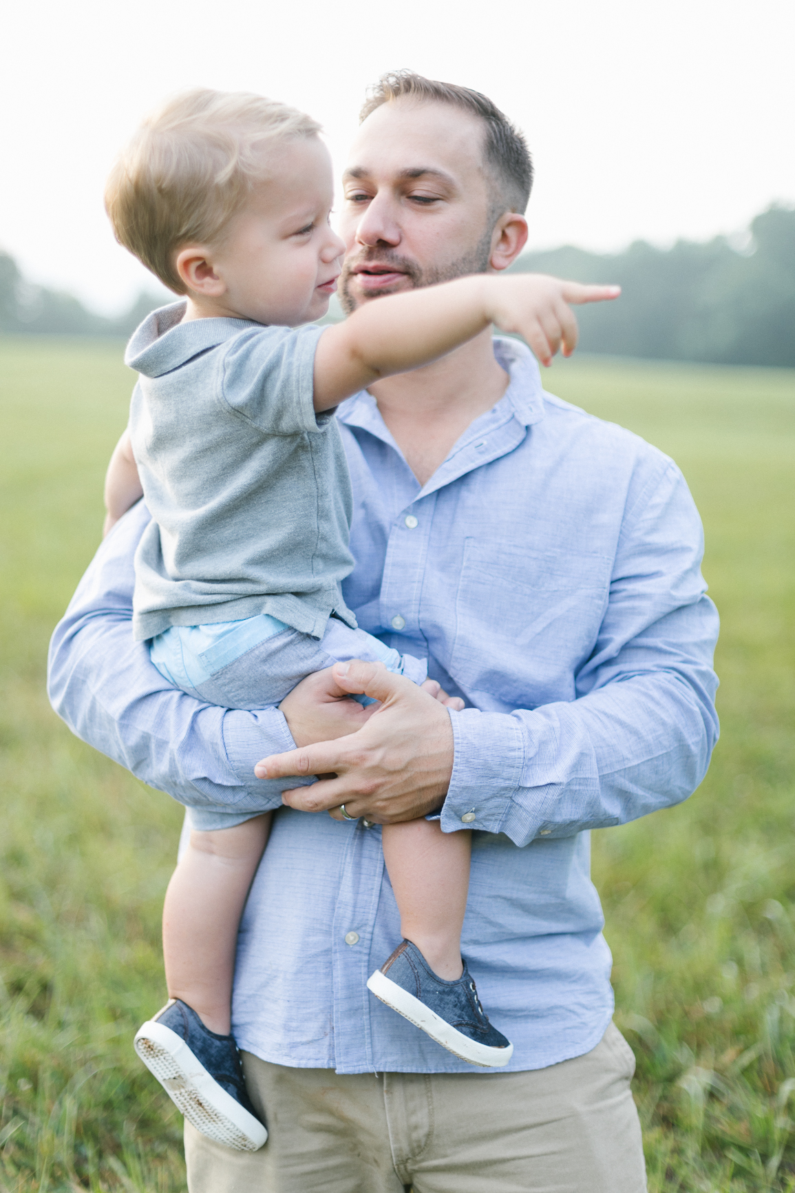 Father and toddler in North Carolina field for a lifestyle family photography session