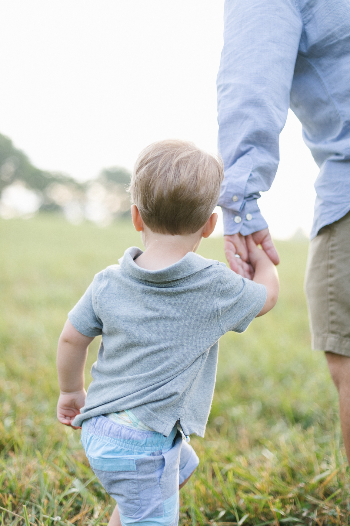 Dad-Son-holding-hands-in-Charlotte-NC-Field-Lifestyle-photography.