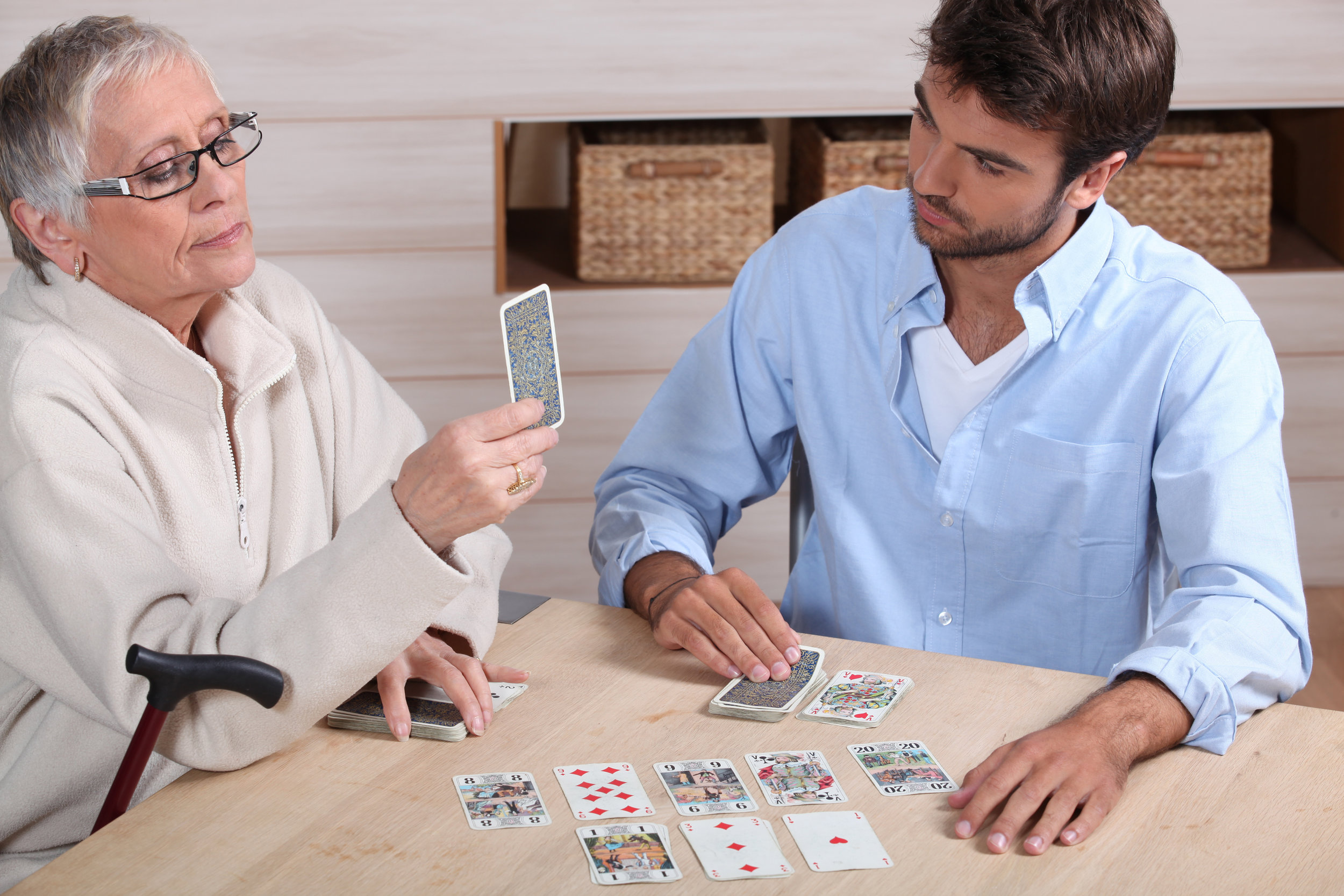 Card games are an excellent non-app option for cognitive stimulation, and have the added benefits of social communication.
