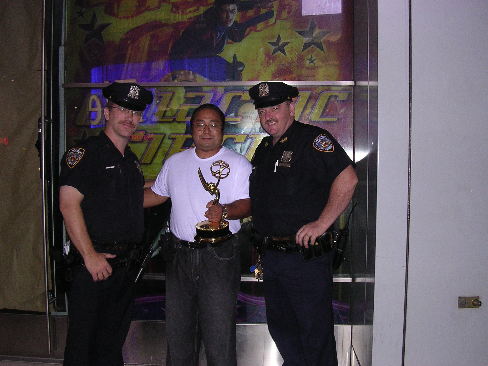 The very first folks to take a victory tour photo with Emmy was two of New York's finest. This was the beginning of my version of the Stanley Cup Tour.