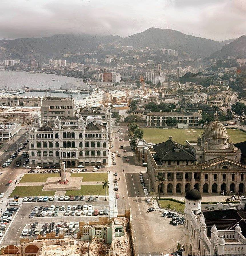 Photograph of central district showing the Supreme Court on the right, the old Hong Kong Club building and the Royal Hong Kong Cricket Club grounds!