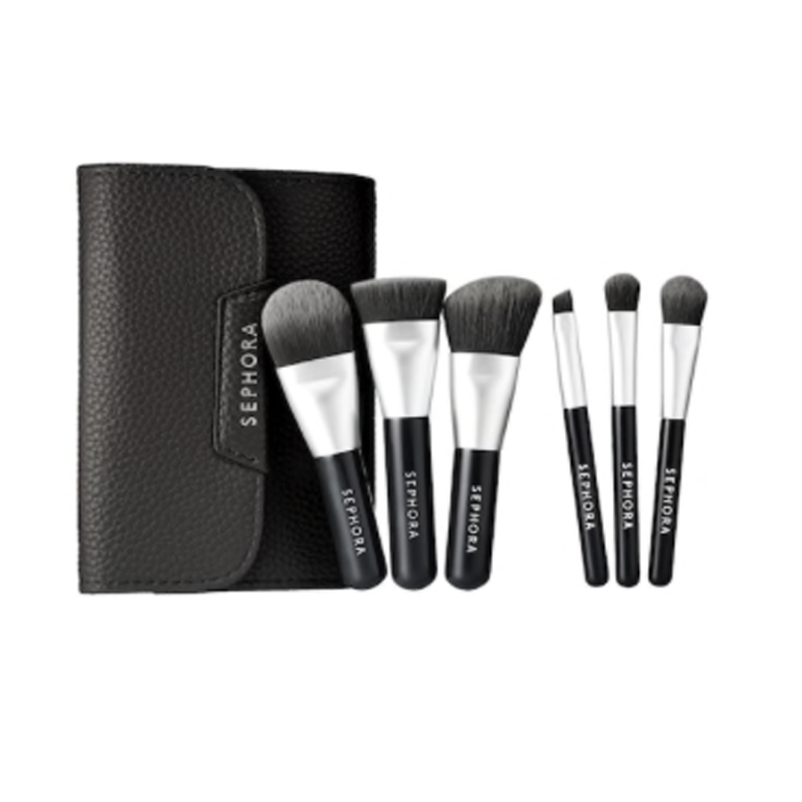 sephora travel brush set - The Sephora Mini brush set has been a great alternative to carrying full size brushes when traveling. This six-piece set comes in a black leather case with a concealer, angled-blush, precision sweep, shadow, angled shadow and foundation brush. The bristles are soft, which made applying product easy, and they are infused with charcoal! Check out my fave on-the-go product at your nearest Sephora