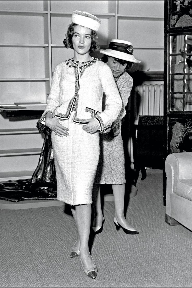 Coco-Chanel-in-her-atelier-fitting-actress-Romy-Schneider-in-the-1960s.jpg