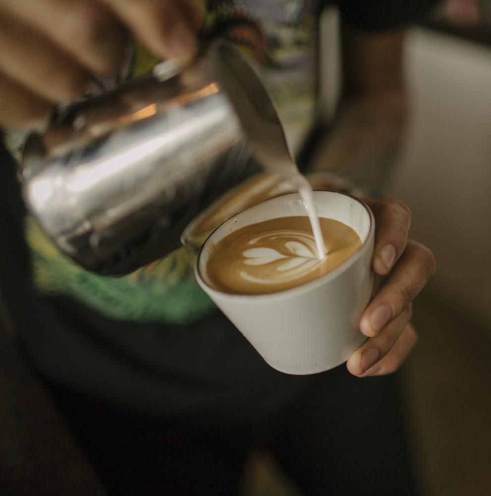 leon pouring latte.jpg