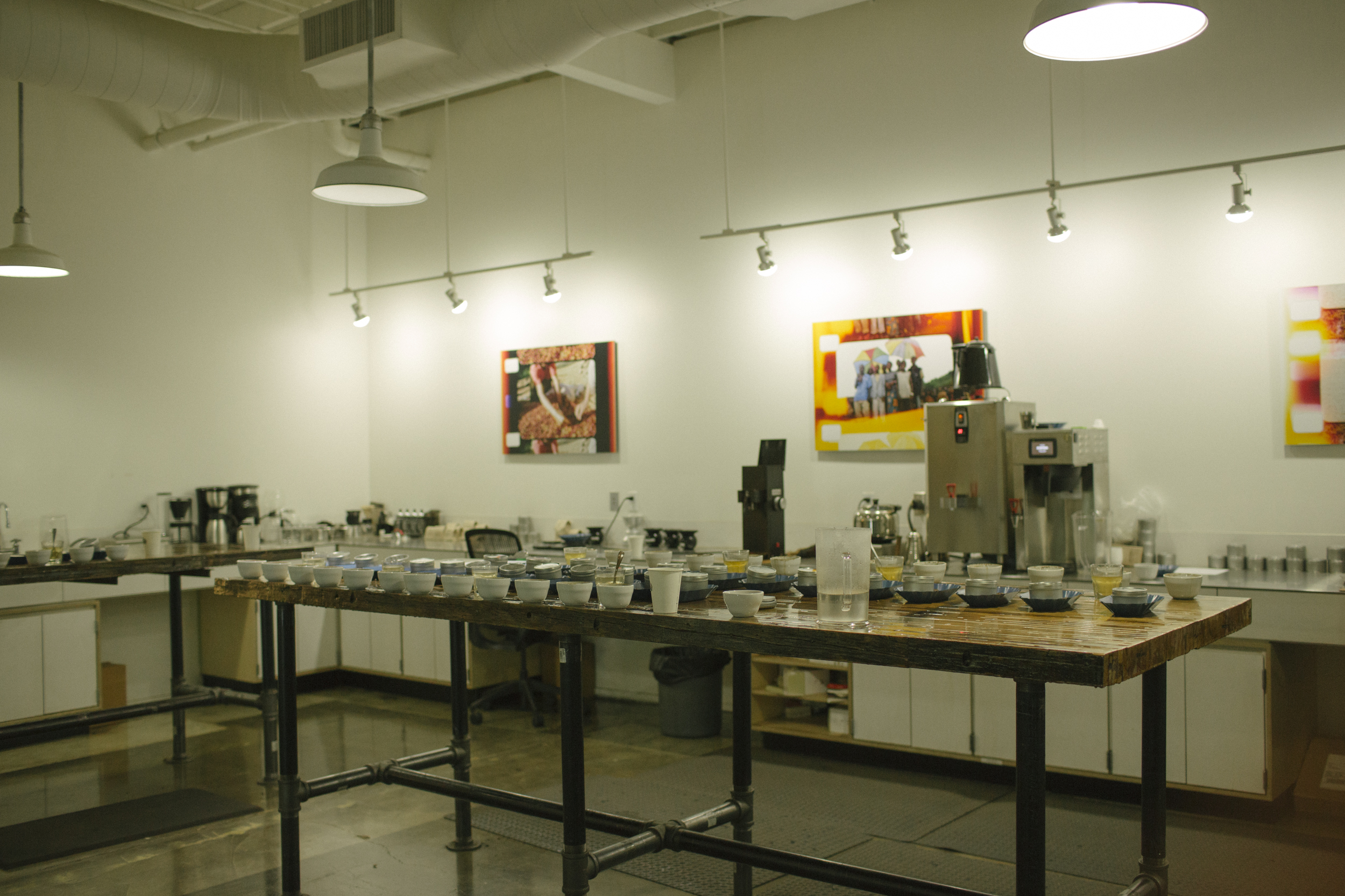 A room dedicated to cupping different coffee's. The person in there asked not to be photographed - Which I gladly obliged - but we had a great conversation about cameras/coffee. And I wanted to just chill in there all day cupping different coffees. What a job!