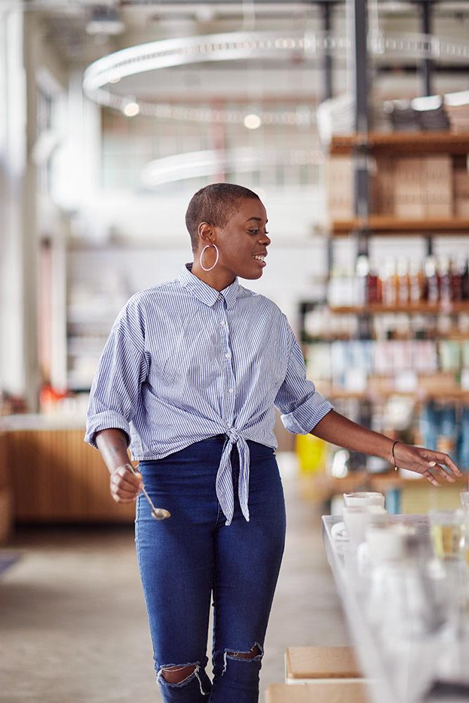 woman-walking-in-restaurant-in-jeans.jpg