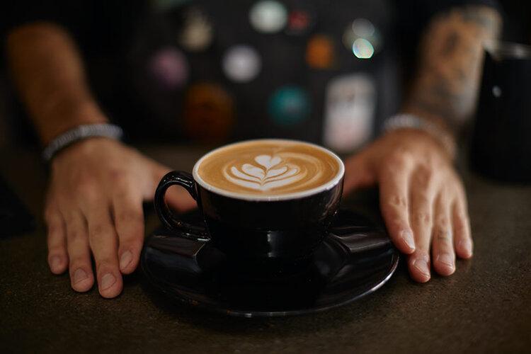 barista-giving-coffee-to-camera.jpg