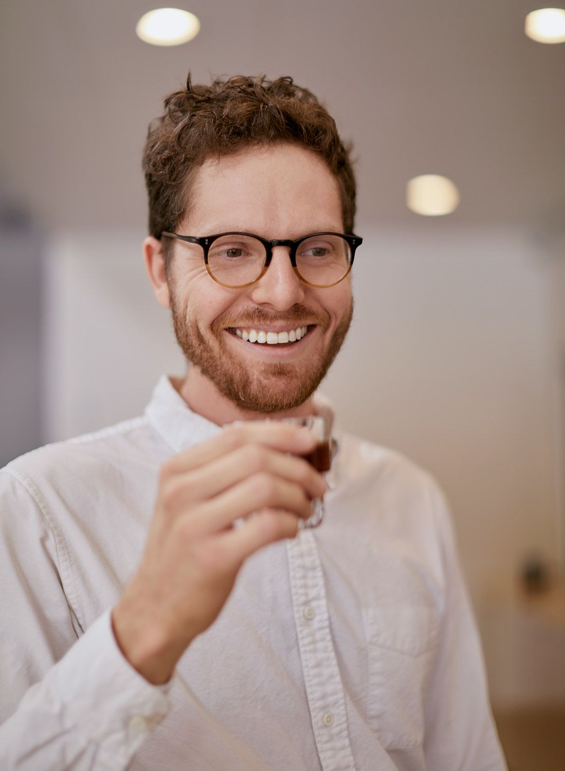 smiling-barista-with-glass-drinking-coffee.jpg