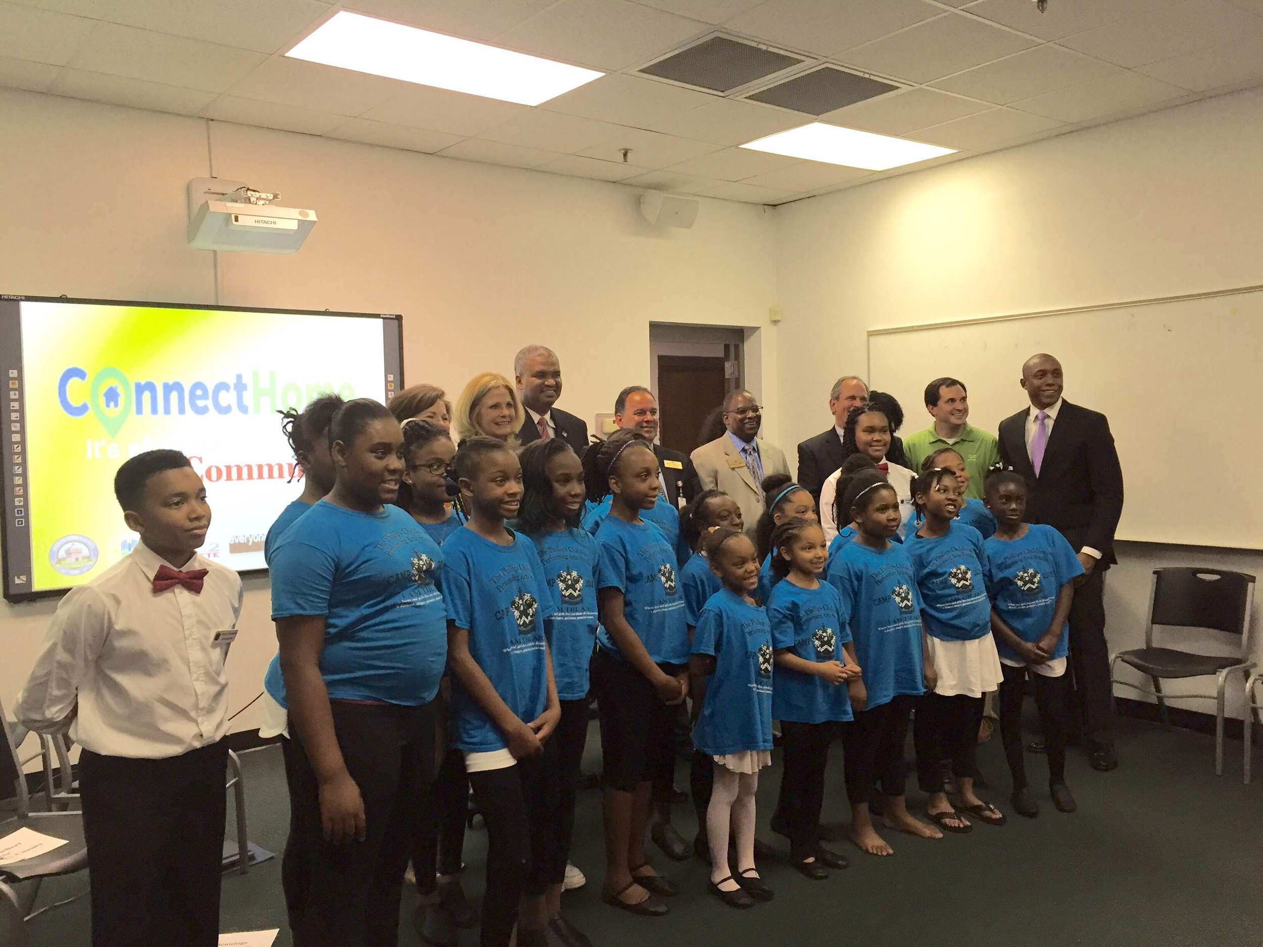 Chike celebrates with students at the launch of the ConnectHome initiative in Macon. EveryoneOn serves as the non-profit lead for ConnectHome and works on the ground in cities like Macon to help all Americans get online.