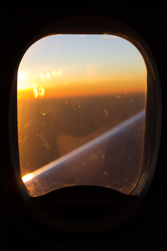 Out of all my photos of plane windows, the egg yolk sunrise makes this is my ultimate favourite • Somewhere between Kenya and Ethiopia •