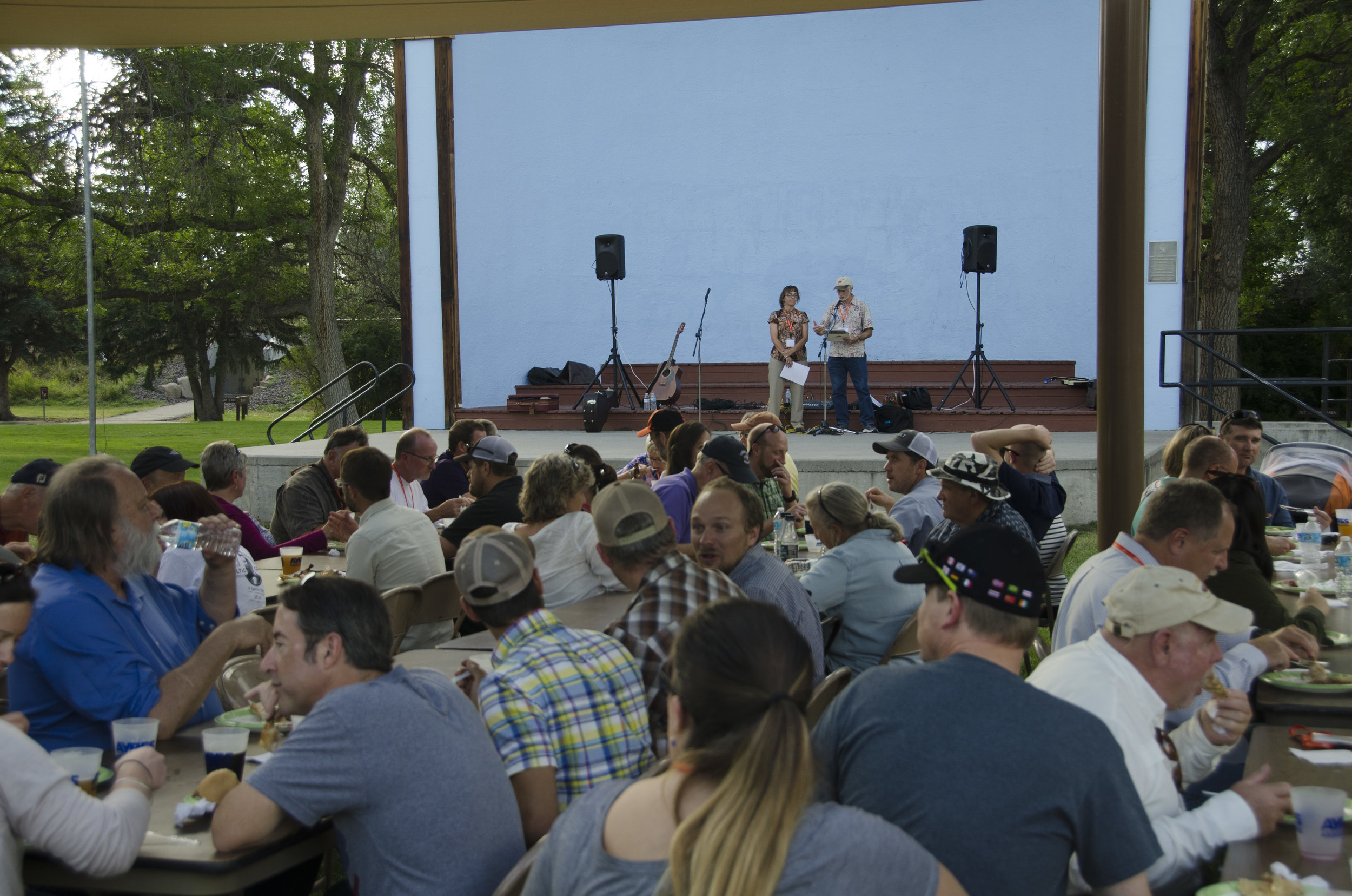 AWARDS DINNER.  Angela Parker, AICP, and Dan Pava, AICP, announce the 2016 Western Planner Awards at the annual barbecue held this year in Great Falls. Photo by Rachel Girt.
