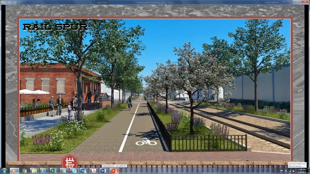 FIGURE 9 - A SCREENSHOT FROM THE 3D ANIMATION OF THE RAIL SPUR CONVERSION OF DISORGANIZED RIGHT-OF-WAY INTO A MULTI-MODAL FACILITY SUPPORTING BICYCLE AND PEDESTRIAN CIRCULATION CONNECTING BUSINESSES AND RESIDENTS IN THE WEST EDGE. (COURTESY CITY OF CHEYENNE)
