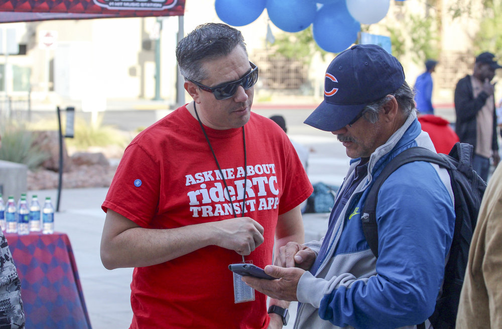 STREET TEAMS COMPRISED OF RTC STAFF AND EXTERNAL PERSONNEL DIRECTLY MARKETED ITS NEW SMARTPHONE TRANSIT TICKETING AND TRIP PLANNING APP, RIDERTC, TO CUSTOMERS, ULTIMATELY INTERACTING WITH MORE THAN 4,100 CUSTOMERS AT 90-PLUS OUTREACHES HELD AT TRANSIT FACILITIES AND BUS STOPS THROUGHOUT THE VALLEY OVER A PERIOD OF THREE MONTHS.   PHOTO PROVIDED BY RTC.