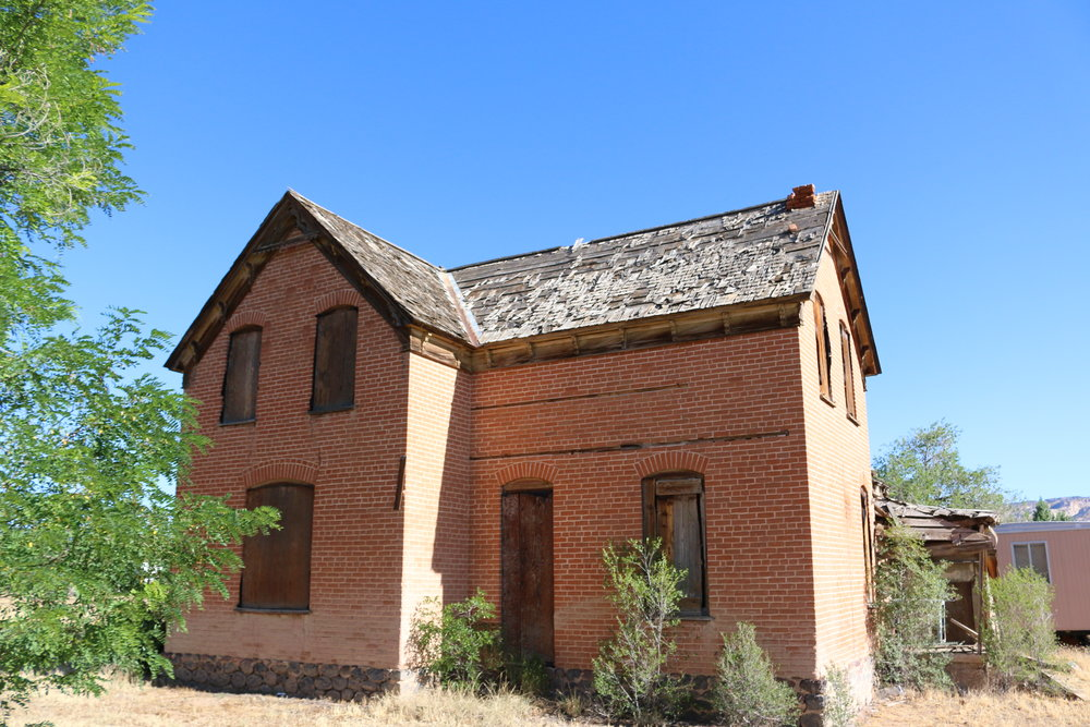 DILAPIDATED HISTORIC HOME ON MAIN STREET, INDICATIVE OF SEVERAL PROMINENT HOMES IN ESCALANTE.  PHOTO PROVIDED BY RURAL PLANNING GROUP.