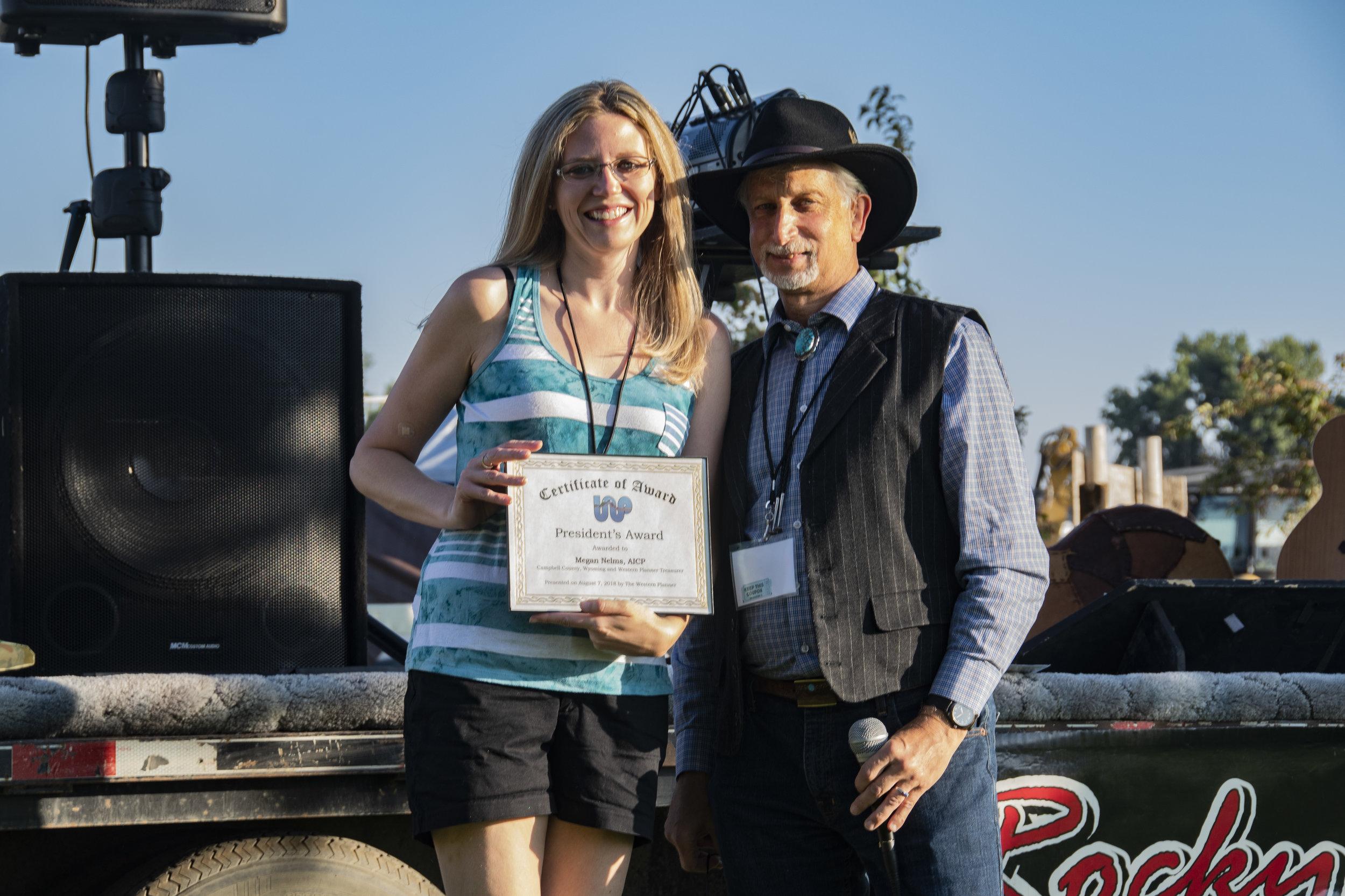 Megan Nelms, AICP receives President's Award from Dan Pava, FAICP.