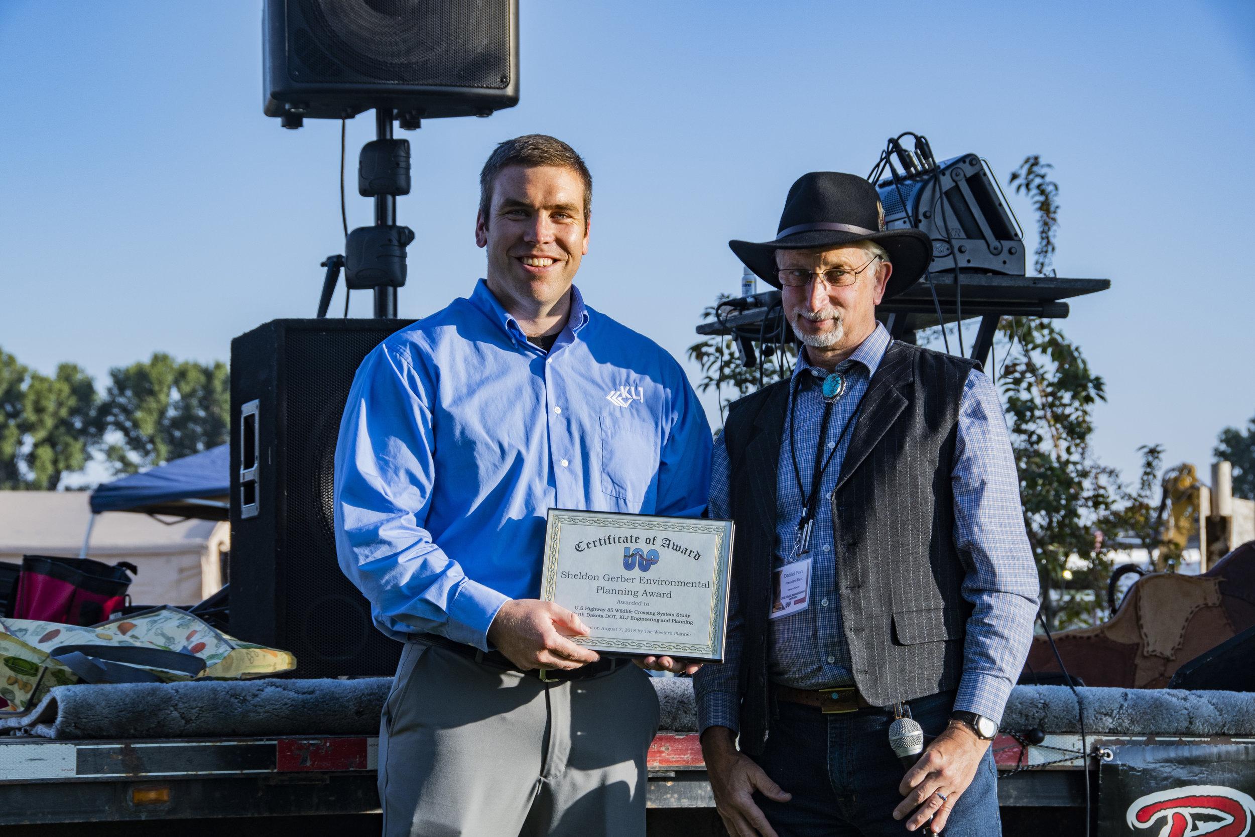 Luke LaLiberty accepted the award from Dan Pava, FAICP.