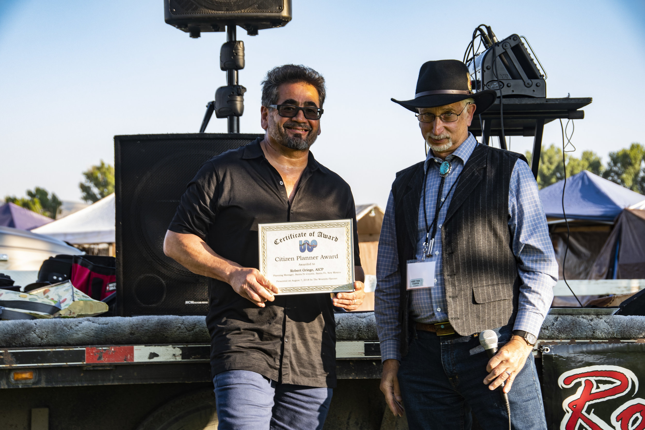 Robert Griego, AICP accepts award from Dan Pava, FAICP.