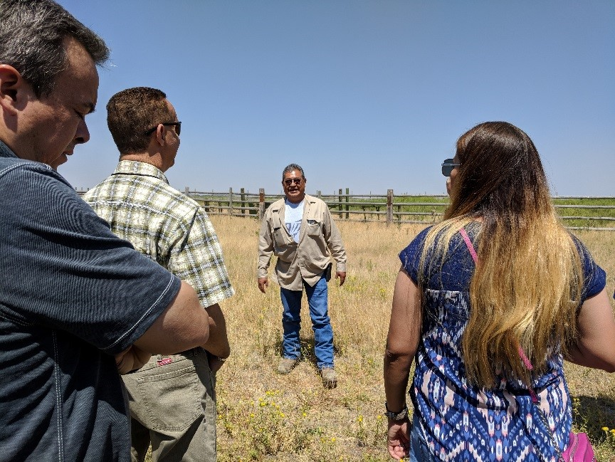 Tribal Transportation Director and Tribal Member, Anthony Broncho, telling us about the bison and giving some of the history of the Shoshone-Bannock Tribes. Photo by Angela Parker, AICP, CFM.
