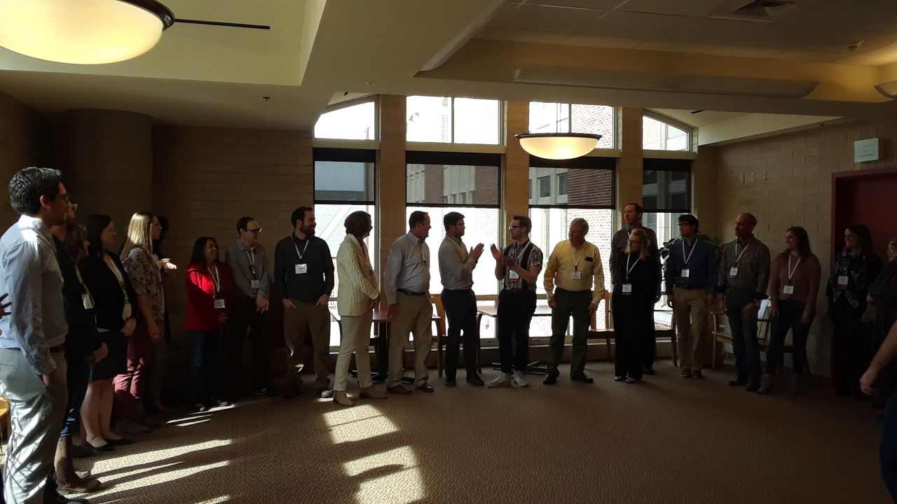 """Participants in the """"Residents Gone Wild"""" presentation get out of their seats and into the hallway to practice improvisational techniques. This untraditional panel at the 28th Rocky Mountain Land Use Institute, provided practical tips to save meetings from going south, from an attorney, a professional facilitator, a planner who is also a yoga instructor, and a comedian."""