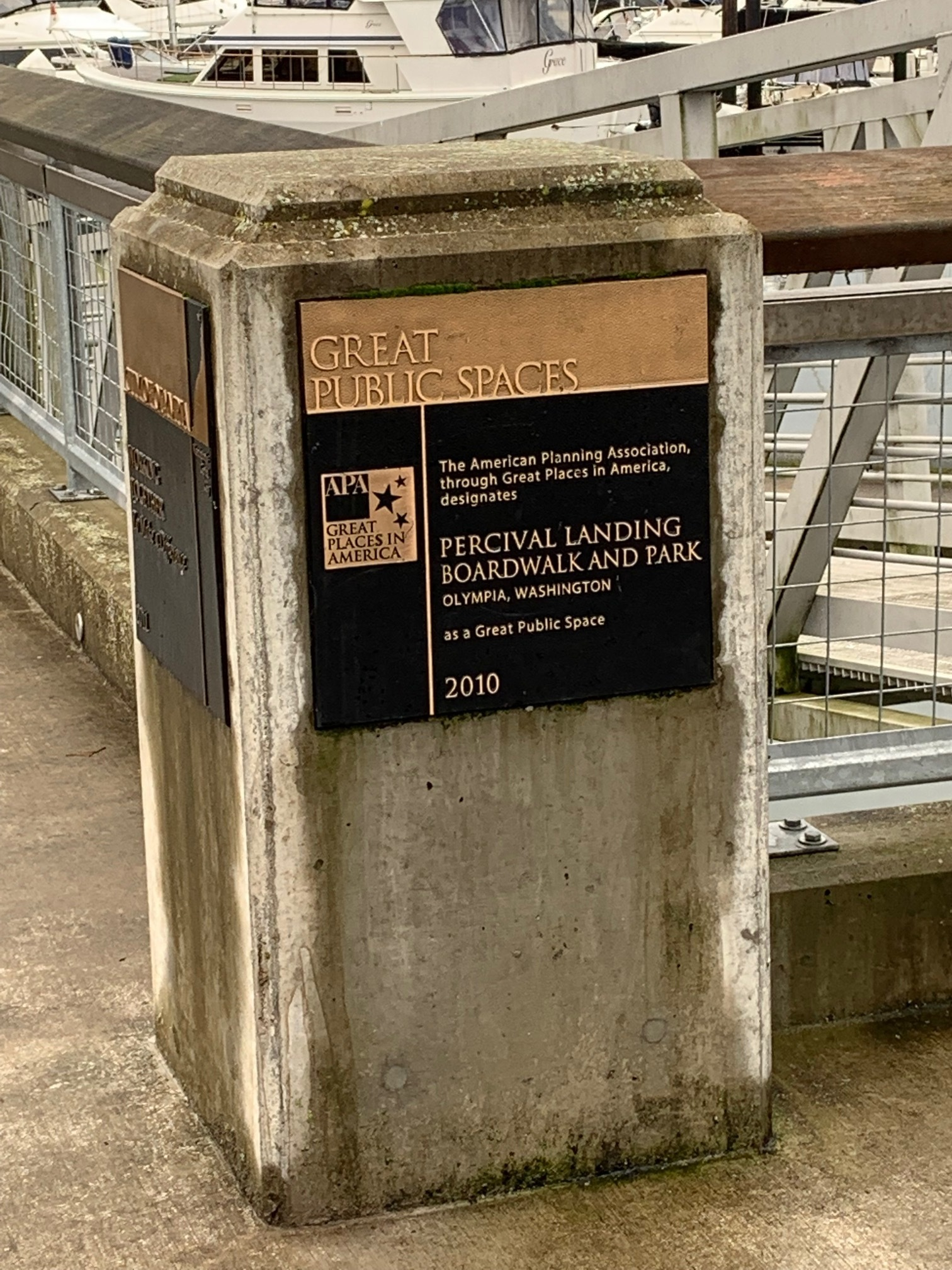 Plaque commemorating APA's Great Places in America award given to the City for Percival Landing in 2010: Courtesy - Candi Millar