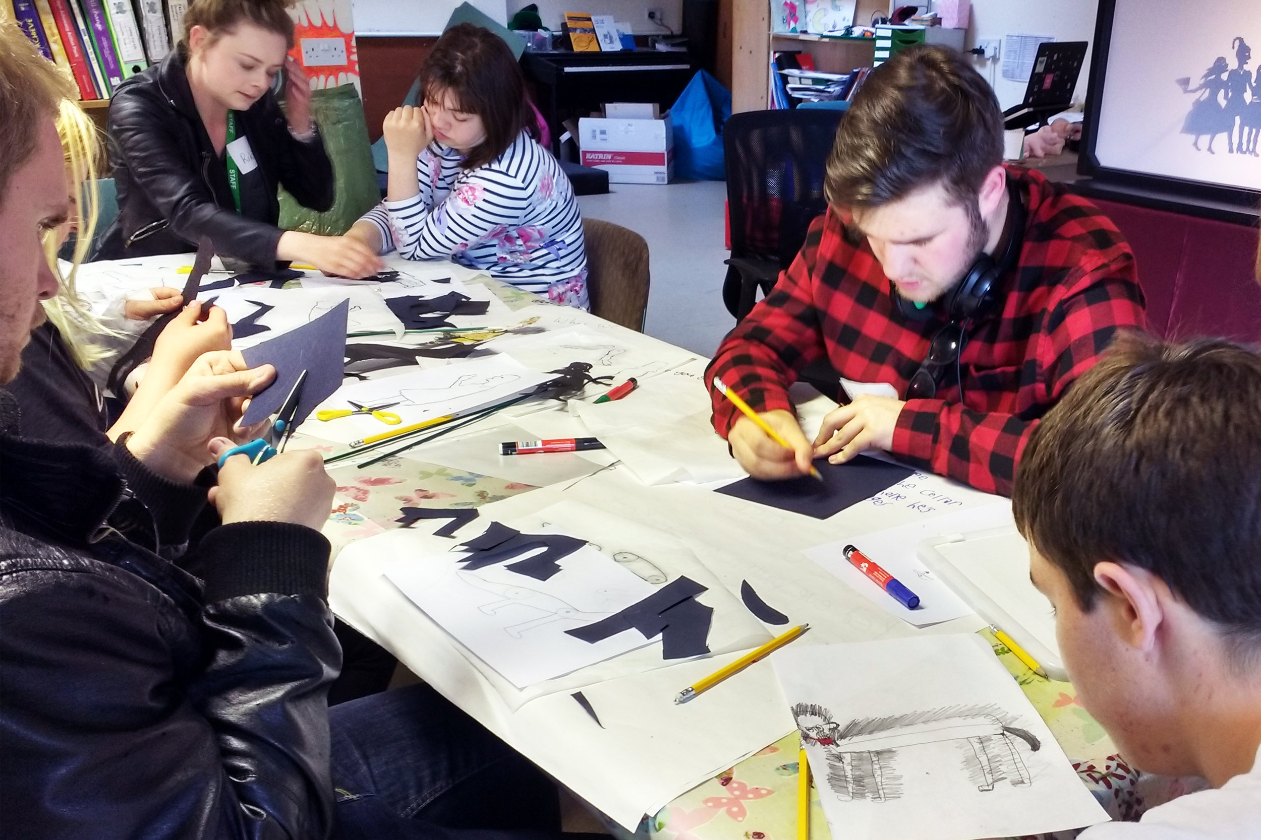 Special needs students designing & making shadow puppets