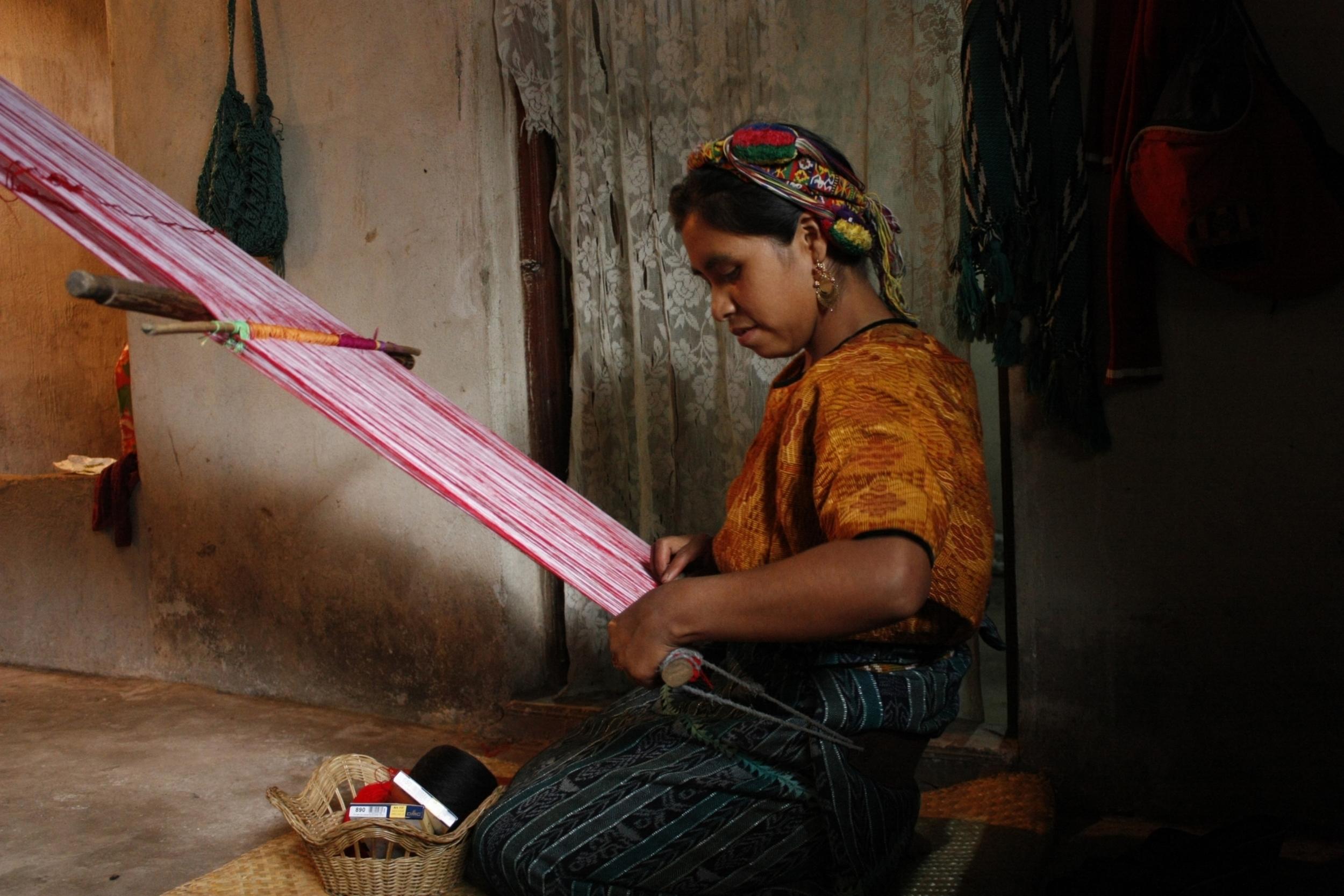 Sofia on her backstrap loom