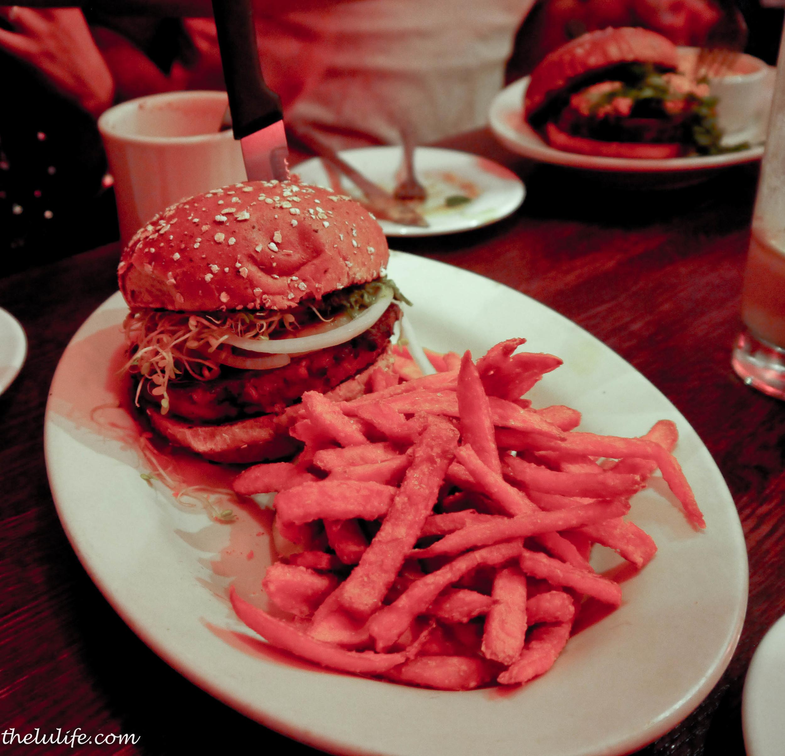 Buddha's Karma Burger - curried sweet potato tofu patty, grilled pineapple, lettuce, onion and chimichurri sauce