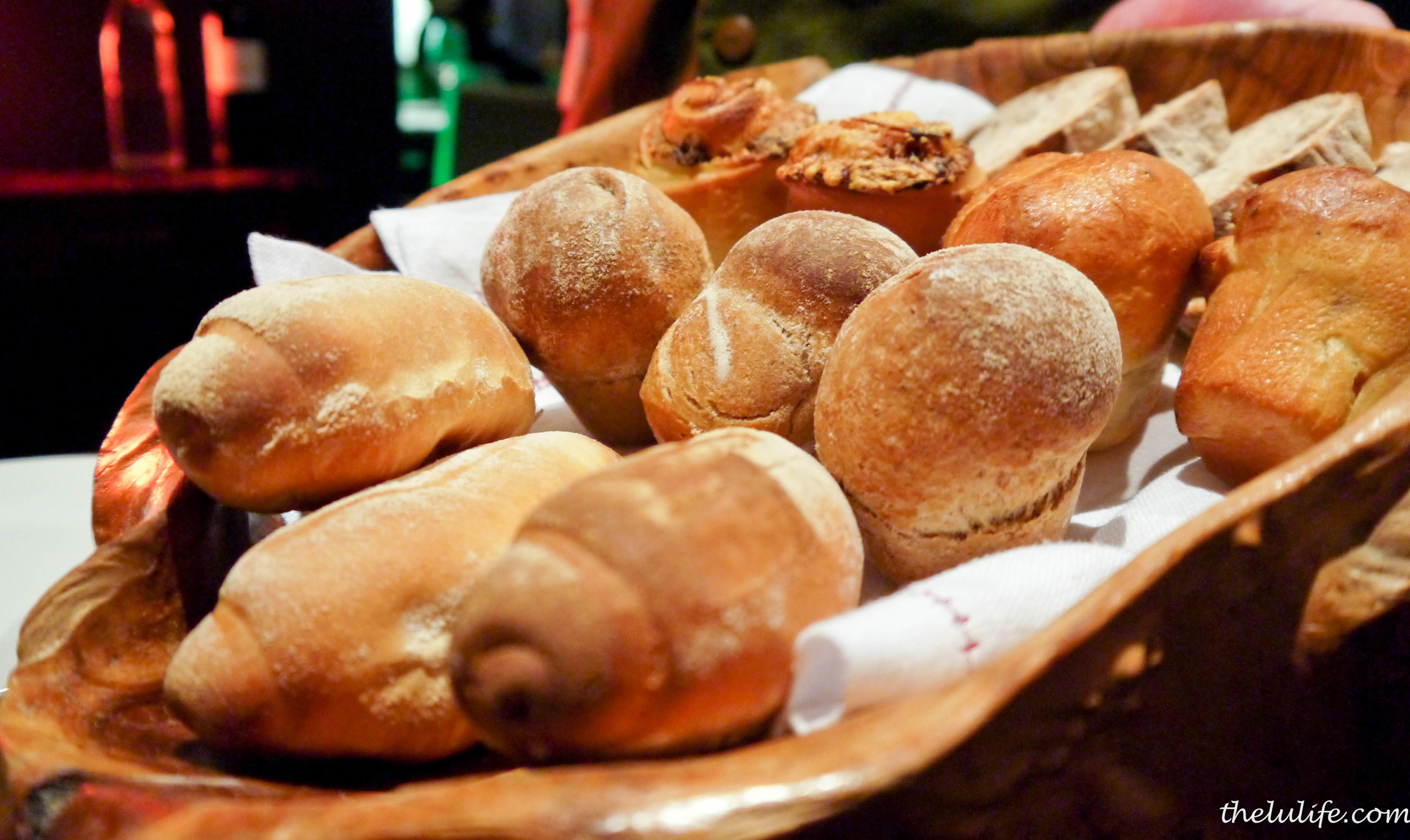 Breads: Guinness, olive and parmesan, almond and brioche, and raisin
